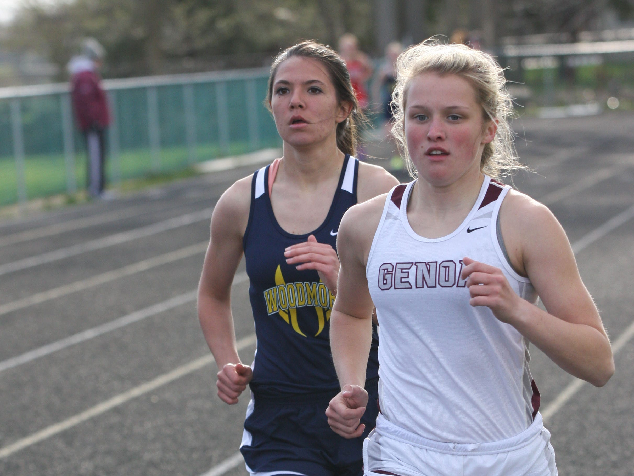 Genoa's Carly Gose and Woodmore's Jessie Wegert battle for the lead in the 800m run.