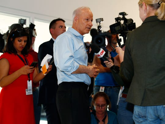 Rep. Mike Coffman, R-Colo., talks to reporters before