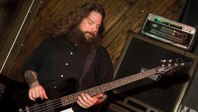 Jason McCash (1976-2014) performs with the Gates of Slumber at Indy's Jukebox in January 2013.