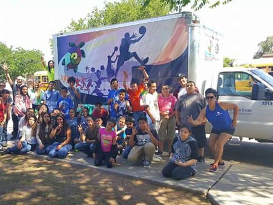 Lynn Middle School students pose in front of the mobile