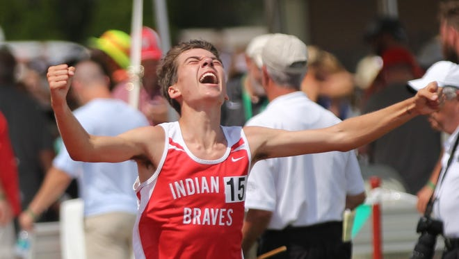 Indian Hill's  Ben Bayless  reacts  after finishing the boys 3200 meter run at the State Track Meet, Saturday, June 3, 2017.