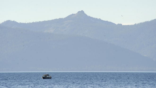 A file photo of a boat floating on Lake Tahoe near Cave Rock taken in 2012. A man drowned Tuesday while kayaking on Lake Tahoe.
