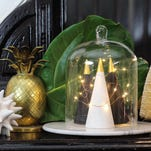 Flameless lace votives are safe to use and easy to make, and they give your mantel a romantic and warm vibe this winter. Photo: Meg Allan Cole/HGTV via AP