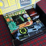 Unboxing the Loot Crate July 2016 Futuristic Box, which includes items from Futuruma, Mega Man, Star Trek, and Rick and Morty. For more details, check our written review.