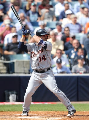 Detroit Tigers infielder Mike Aviles #14 bats during the third inning of the Spring Training Game against the New York Yankees at George Steinbrenner Field in Tampa, Florida.