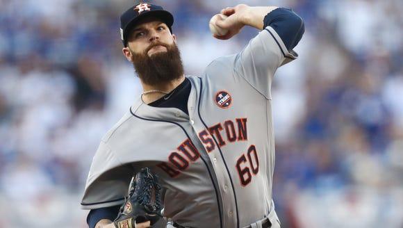Houston Astros starting pitcher Dallas Keuchel throws