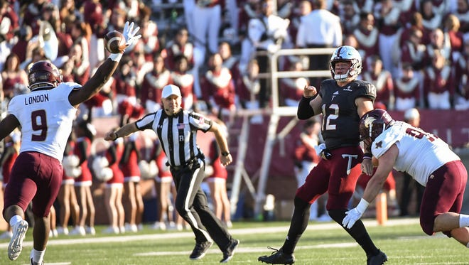 Troy Trojans quarterback Brandon Silvers (12) drops back to pass during a football game between the Troy Trojans and the Texas State Bobcats on Nov. 24, 2017 at Veterans Memorial Stadium in Troy.