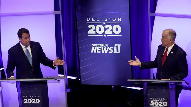 Democratic challenger Cal Cunningham, left, and  U.S. Sen. Thom Tillis, R-N.C., talk during a televised debate Thursday, Oct. 1 in Raleigh.