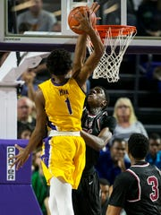 Memphis East's Malcolm Dandridge blocks a shot by Montverde Academy's Rechon Black in the finals of the 44th Annual City of Palms Classic on Wednesday, December 21, 2016, at Suncoast Credit Union Arena in Fort Myers.