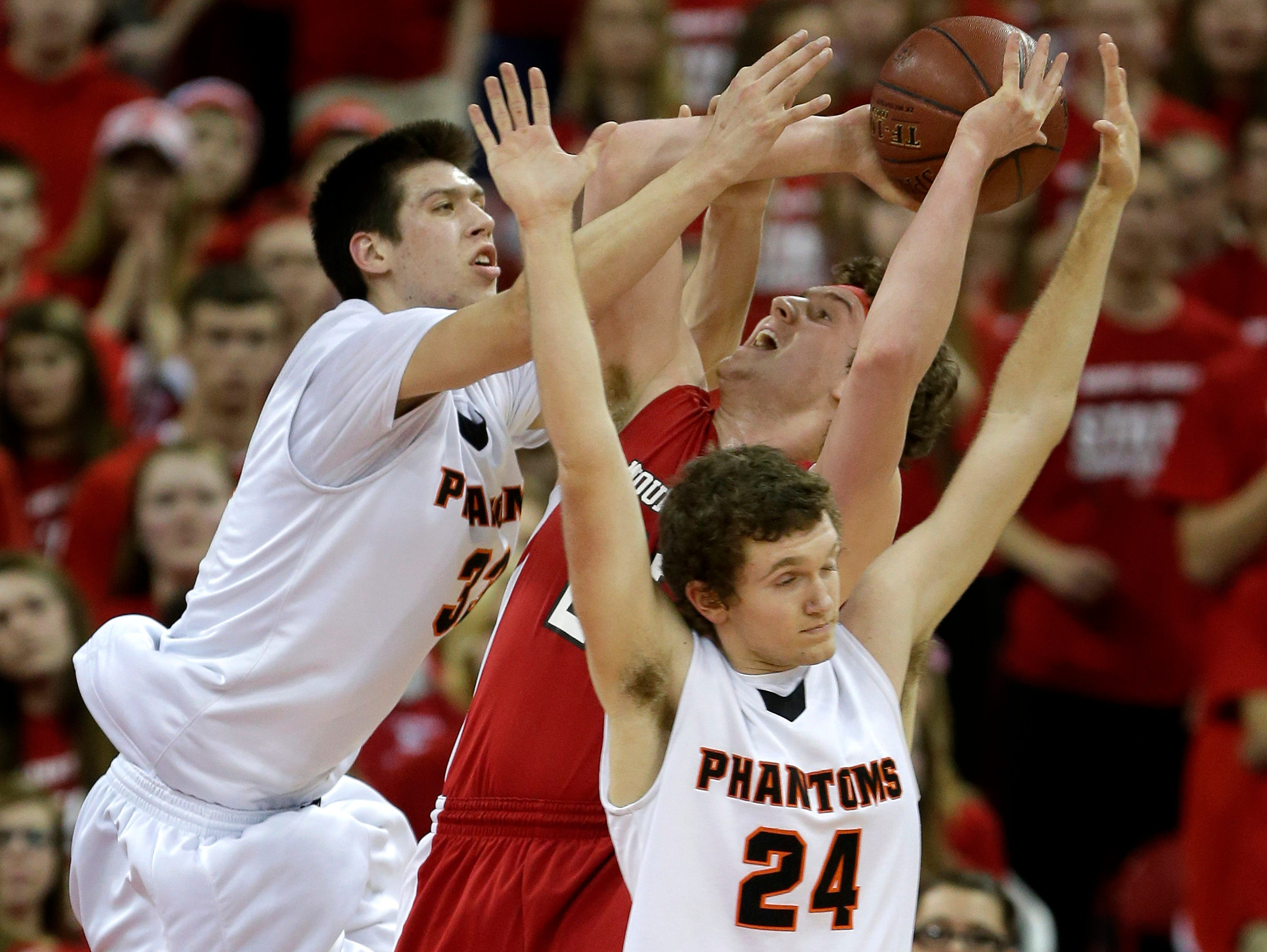 West De Pere High School's #33 Cody Schwartz and #24 Cole Kempen defend against Mount Horeb High School's #24 Nathaniel Osterloo during their Division 2 semifinal basketball game in the 100th annual WIAA State Boys Basketball Tournament at the Kohl Center on March 20, 2015, in Madison, Wis. Wm.Glasheen/Post-Crescent Media