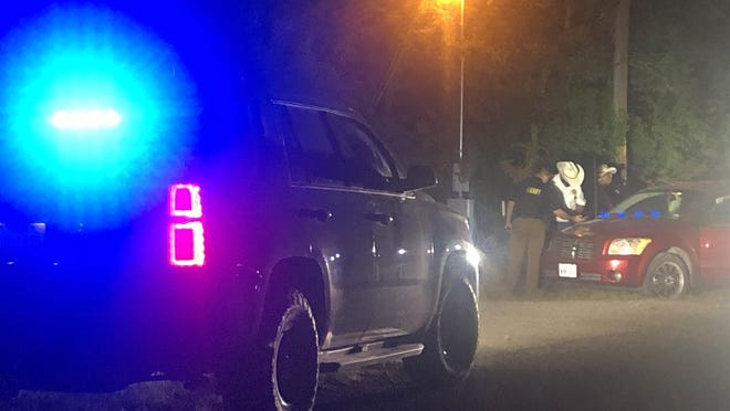 Sheriff Romeo Ramirez and his investigators inspected a vehicle on County Road 303 after two men were shot. Sheriff Ramirez said the vehicle was occupied by the victims. The victims crashed the vehicle and received assistance from nearby residents.