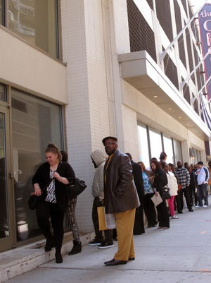 Ronald Roberts, right, waits at the head of the line of applicants for jobs at the Chelsea hotel in Atlantic City on Wednesday. Roberts lost his cook's job last August when the Showboat casino closed.