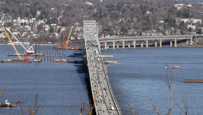 Construction barges and cranes surround the Tappan Zee Bridge on March 31 as work continues on the building of the new bridge.