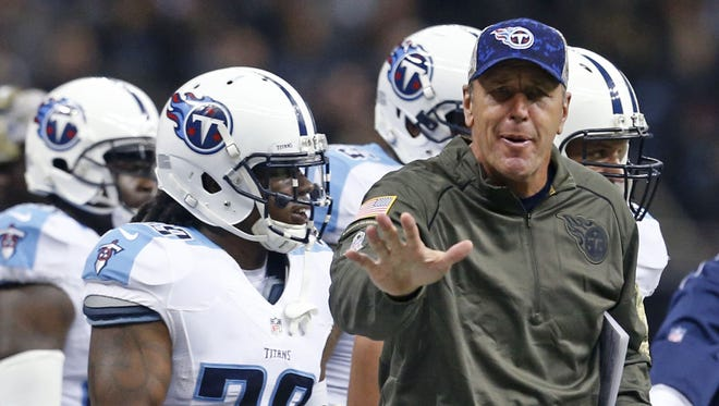 Mike Mularkey makes a call from the sideline in his first game as Titans interim head coach on Nov. 5 against the Saints. Mularkey replaced Ken Whisehunt, who was fired Nov. 3.