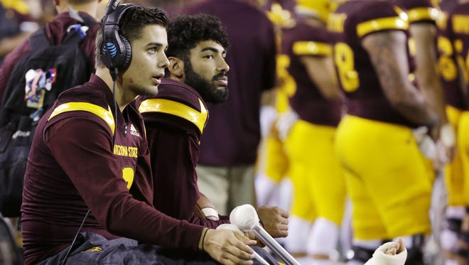 Arizona State quarterbacks Brady White and Manny Wilkins sits on the sideline with injuires against Washington State during PAC-12 action on Saturday, Oct. 22, 2016 in Tempe, Ariz. Manny Wilkins came out of the game after the first offensive series.