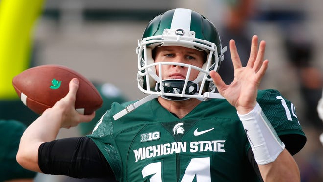 Michigan State Spartans quarterback Brian Lewerke warms up prior to playing the Michigan Wolverines at Spartan Stadium on Oct. 29, 2016 in East Lansing.