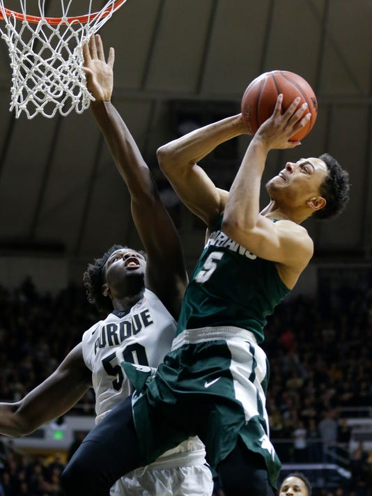 Michigan State guard Bryn Forbes (5) shoots over Purdue forward Caleb Swanigan (50) in the first half of an NCAA college basketball game in West Lafayette, Ind., Tuesday, Feb. 9, 2016. (AP Photo/Michael Conroy)