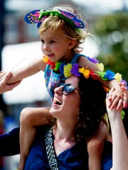 Alexis Nicely, of Knoxville, holds her daughter Josephine Nicely, 5, during the annual Knoxville Pridefest parade Saturday, June 17, 2017.