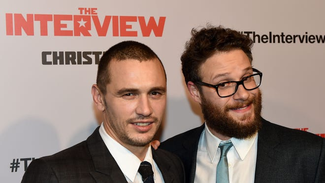 """Actors James Franco, left, and Seth Rogen arrive for the premiere of the film """"The Interview"""" at The Theatre at Ace Hotel in Los Angeles on Dec. 11, 2014."""