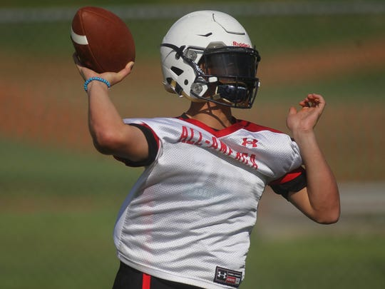Quarterback Paxton Tomaini and Leon's football team practices its first of the fall on Monday, July 30, 2018.