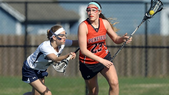 Penfield's Emily Ebersol, right, is one of three seniors leading the Patriots' attack this spring.