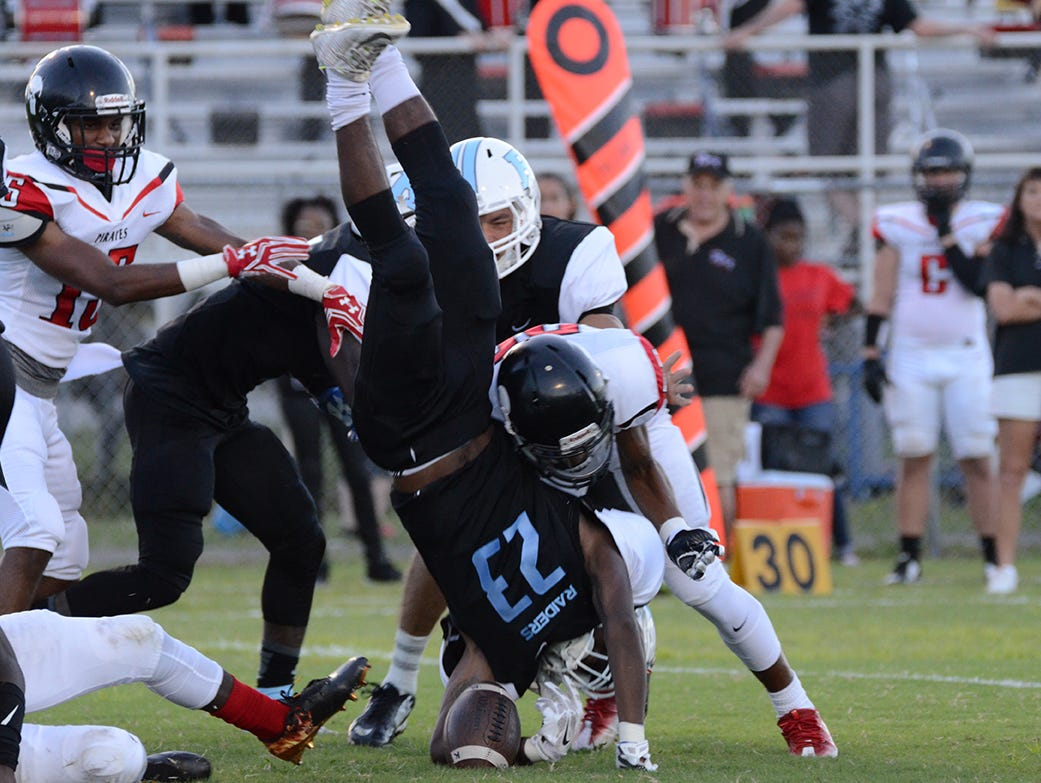 Rockledge Raider Vaurice Griffin Jr. is upended in the opening kickoff Friday night in their home game against the Palm Bay Pirates. (photo by Tony Dees/Florida Today)