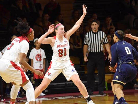 Marist College's Willow Duffell reacts on defense against Navy at McCann Arena in Poughkeepsie on Friday.