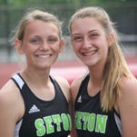 Seton High School junior Anna Schoster, left, and freshman Alexis Gerke run at the GGCL track and field championships May 15 at La Salle.