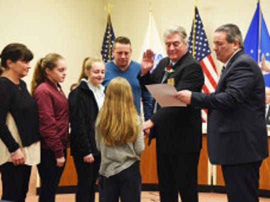 Councilman Henry Ruh is sworn to his fourth three-year term on Palisades Park council.