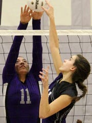 Mescalero's Katelyn Yuzos, left, blocks a ball Thursday