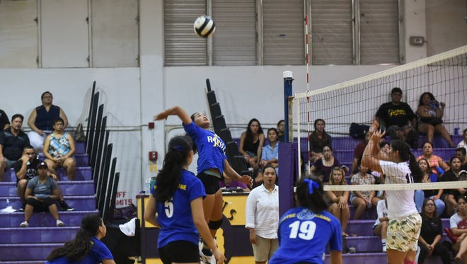 In this file photo, the Notre Dame Royals, in blue, took on the George Washington Geckos for 17th annual Shieh Invitational Volleyball Tournament Championship at the GW gym. The two teams square off Friday night.