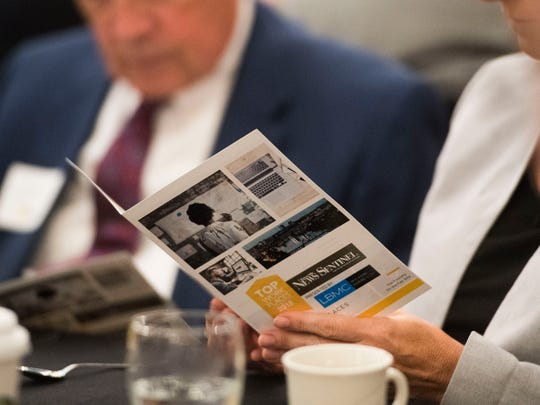 An attendee holds a program during the News Sentinel's