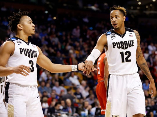 Mar 23, 2018; Boston, MA, USA; Purdue Boilermakers guard Carsen Edwards (3) and forward Vincent Edwards (12) celebrate a score against the Texas Tech Red Raiders during the second half in the semifinals of the East regional of the 2018 NCAA Tournament at the TD Garden. Mandatory Credit: Greg M. Cooper-USA TODAY Sports
