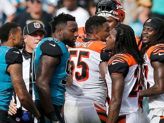 Jacksonville Jaguars defensive end Yannick Ngakoue (91) and Cincinnati Bengals cornerback Adam Jones (24) exchange words after benches clear following a fight between Cincinnati Bengals wide receiver A.J. Green (18) and Jacksonville Jaguars cornerback Jalen Ramsey (20) late in the second quarter of the NFL Week 9 game between the Jacksonville Jaguars and the Cincinnati Bengals at EverBank Field in Jacksonville, Fla., on Sunday, Nov. 5, 2017. At halftime the Bengals trailed 10-7 after wide receiver A.J. Green was ejected for throwing a punch.
