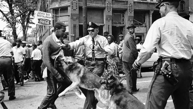 A 17-year-old civil rights demonstrator, defying an anti-parade ordinance of Birmingham, Ala., is attacked by a police dog on May 3, 1963.  On the afternoon of May 4, 1963, during a meeting at the White House with members of a political group, President Kennedy discussed this photo, which had appeared on the front page of that day's New York Times.