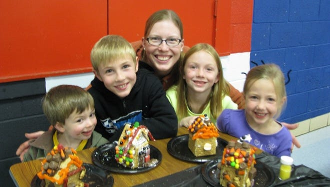 Elkhart Lake-Glenbeulah Elementary School families with students in grades JK-4 were invited to the literacy event Spooky Stories Night. Students and their parents/grandparents spent the evening reading in the library with flashlights and had a fall snack. After, families were invited to the cafeteria to make a spooky graham cracker house to take home.