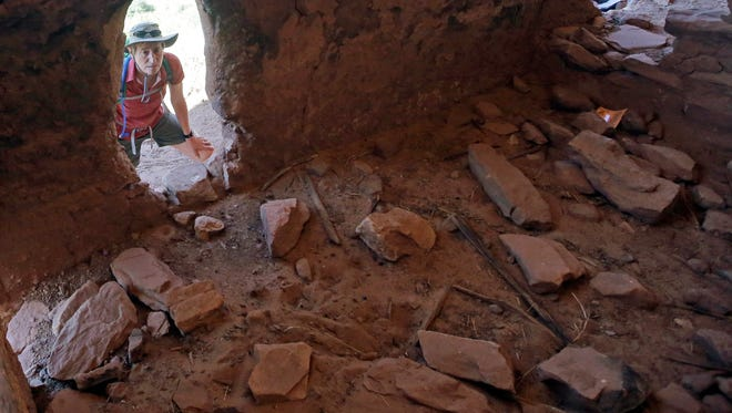 """U.S. Interior Secretary Sally Jewell tours the """"Moonhouse"""" in McLoyd Canyon Friday, July 15, 2016, near Blanding, Utah. Jewell toured archaeological sites in southeast Utah that a coalition of American Indian tribes and environmental groups want to see protected as a new national monument."""