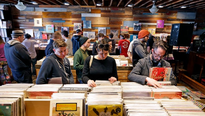 Throngs of vinyl lovers crowd into Acme Records on April 16, 2016, as part of Record Store Day in Milwaukee.