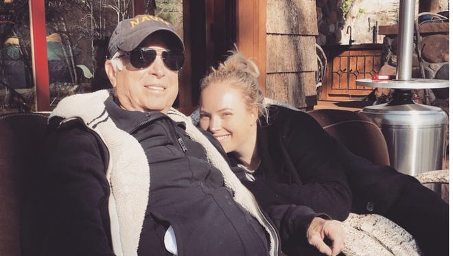 Sen. John McCain and his daughter, Meghan McCain, sitting outside the family's cabin in Sedona in February 2018.