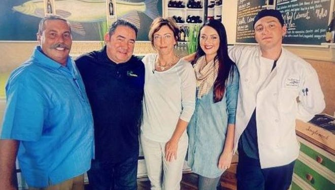 John Foy, left, celebrity chef Emeril Lagasse, Mona Foy, Lindsay Duensing, and chef Corey Foy at the Fat Snook in Cocoa Beach.