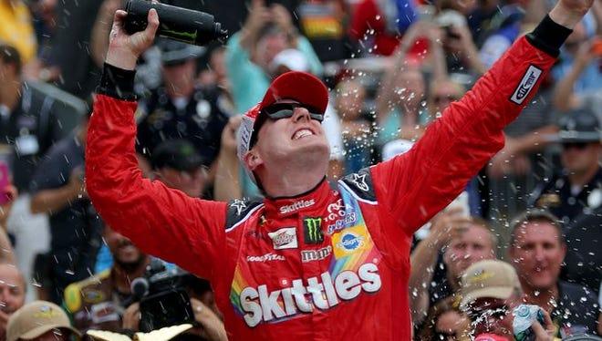 Kyle Busch celebrates winning the Brickyard 400.