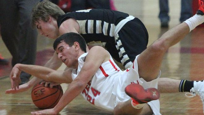 Tappan Zee's Rob McWilliams fights for a loose ball with Nanuet's Terence Rogers during their game at Tappan Zee Jan. 6, 2016. Tappan Zee won 59-46.