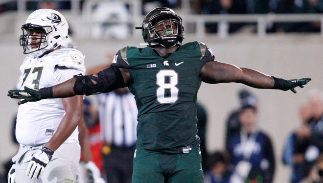 Michigan State defensive lineman Lawrence Thomas (8) celebrates during the fourth quarter against Oregon