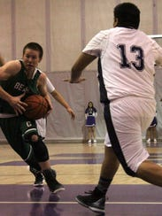 Cloudcroft's Zach Camino attempts to get by Mescalero's
