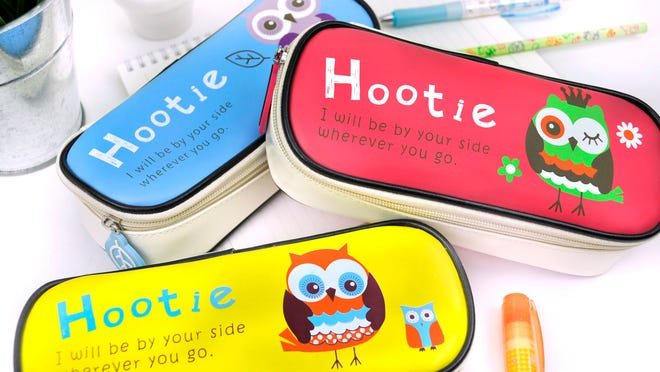 This product image released by Coolpencilcase.com shows a selection of Hootie the Owl Pencil Cases. The average family with kids in kindergarten through 12th grade will spend $669.28 on apparel, shoes, supplies and electronics, up five percent from last year, according to the trade group's 2014 Back-to-School Survey.
