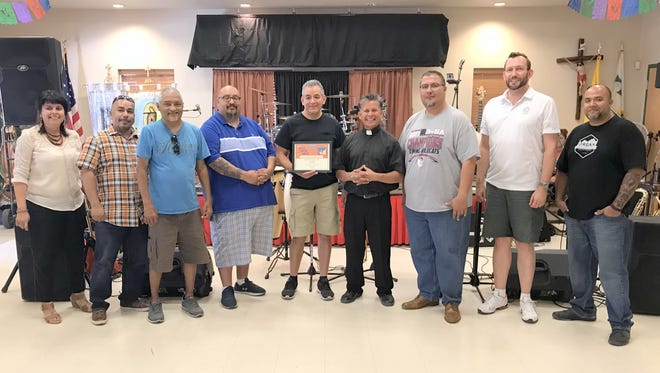 The Caliente Show Band of Las Cruces was honored on Sunday, June 24 for participating in the 100th anniversary celebration of Santa Ana Catholic Church in Deming, NM. The band is pictured with Fr. Manuel Ibarra and co-festival organizer Christine Milo. The band is scheduled to play from 6-9 p.m. on Friday, June 29 during the St. Clair Winery's Music on the Lawn series. Admission is free and the winery is located at 1325 De Baca Road, just off NM Hwy. 549 (Old Las Cruces Highway).