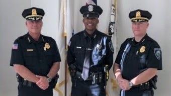 Avon police officer Hans Guillaume (center), standing between Avon Police Chief Jeffrey Bukunt (left) and Deputy Chief Denis Linehan, was sworn in June 25.