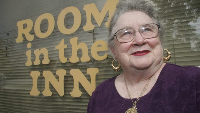Christine Huddleston, Room in the Inn director, stands outside the mission at 640 W. Main St. in Murfreesboro.
