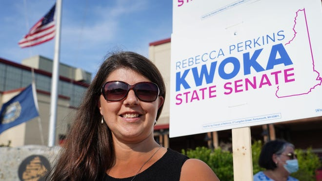 Rebecca Perkins Kwoka of Portsmouth campaigns outside of the polls at Portsmouth High School on Sept. 8, 2020, during primary voting.