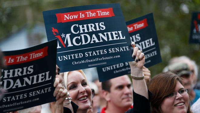 Supporters of state Sen. Chris McDaniel cheer as he announces his candidacy for the U.S. Senate in 2014, during a rally in Ellisville, Miss., last month.